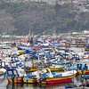 The Port San Antonio Harbor area is congested with many small fishing vessels in Santiago, Chile.