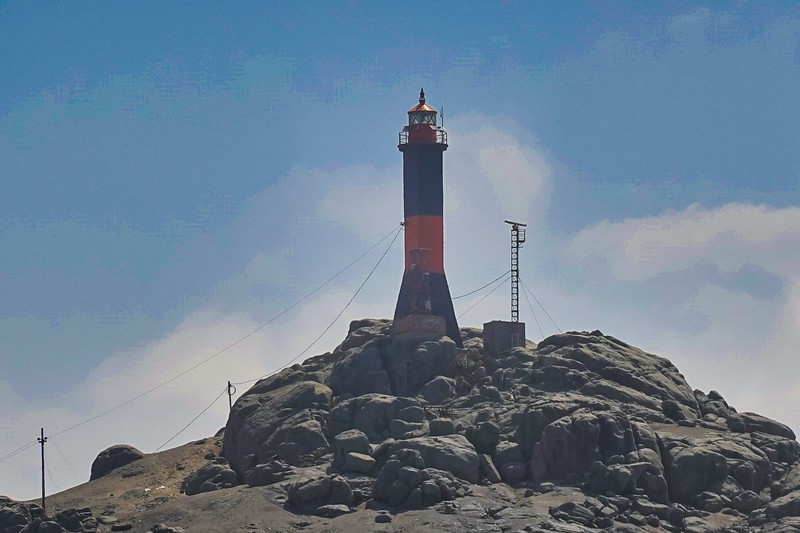 Lighthouse on the rocks at the Port of Salaverry, Trujillo, Peru.