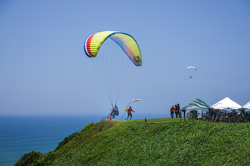 Hang gliding at the beach, adjacent El Parque del Amor, in Lima, Peru.