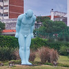 "In 2012, South Korean artist Yoo Young-ho bequeathed a six meter tall, light-blue colored statue of a bowing man called ""Greeting Man"" to Montevideo, Uruguay. It stands overlooking the River Plate in the Buceo neighborhood of the city. Greeting Man has become known locally –and not unaffectionately– as ""Man gazing at his balls""."