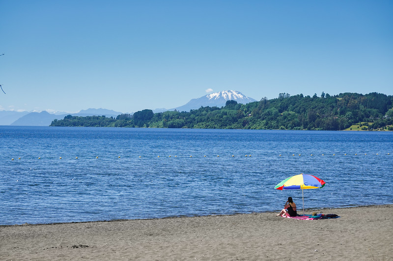Beach at Lake Llanquihue, with Volcano  Calbuco visible across the lake, Puerto Varas, Chile.