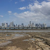 Panama shore at low tide, a bridge and a modern Panama City in the background, Panama.