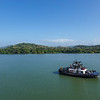 A tug accompanies us as we transit Lake Gatun, part of the Panama Canal ship's transit.