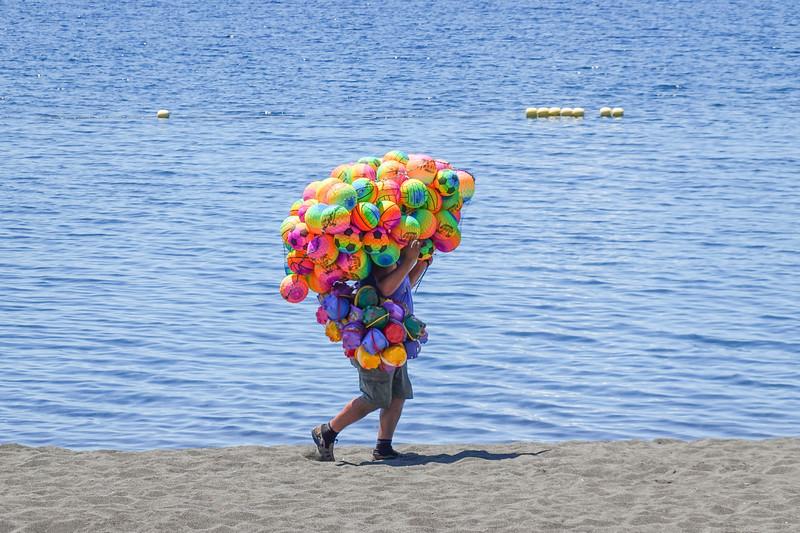 Beach ball seller, Puerto Varas, Chile.