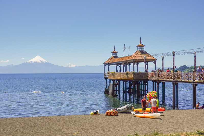 Beach and pier at Puerto Varas overlook the Osomo Volcano, Puerto Varas, Chile.