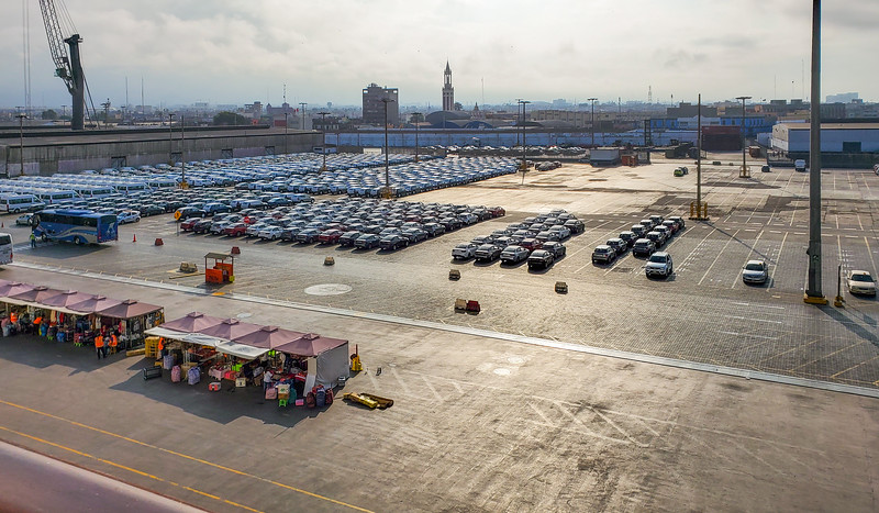 Vehicles and souvenir sellers lined up in the Port of Lima, Peru.