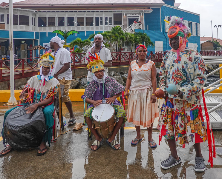 Greeted on shore by a local band in the rain. Roatan, Honduras.