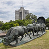 Located in Park Batlle, Montevideo, Uruguay, this sculpture was created by Jose Belloni to honor Ox Cart drivers of the 19th century.