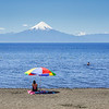 The beach at Lake Llanquihue with Volcano  Osomo visible across the lake, Puerto Varas, Chile.
