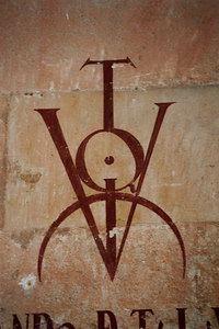 """The logos are """"v"""" for victory.  The very top students get to write these on the wall and they mix in some blood - Salamanca, Spain ... March 2003 ... Photo by Rob Page III"""