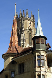 The tower of Cathdrale de St Nicholcas hides behind other towers - Fribourg, Switzerland ... March 4, 2007 ... Photo by Rob Page III
