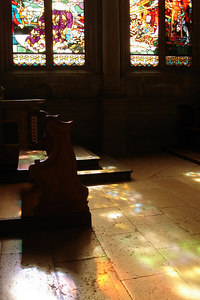 The stain glass reflects off of the ground - Fribourg, Switzerland ... March 4, 2007 ... Photo by Emily Conger
