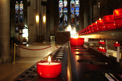 Candles inside the Catedral de St Nicholas - Fribourg, Switzerland ... March 4, 2007 ... Photo by Emily Conger