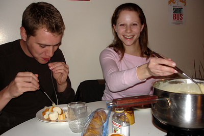 Rob and Emily enjoying fondue - Geneva, Switzerland ... March 4, 2007 ... Photo by Michael Ruprecht