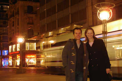 Michael and Emily on Rue de Rhone at night with a tram speeding by - Geneva, Switzerland ... March 4, 2007 ... Photo by Rob Page III