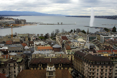 "The city spreads out below Cathedral de St Pierre.  In the distance is the ""Jet d'Eau."" It shoots water into the air at 200 km/h to create a 140m plume - Geneva, Switzerland ... March 2, 2007 ... Photo by Rob Page III"