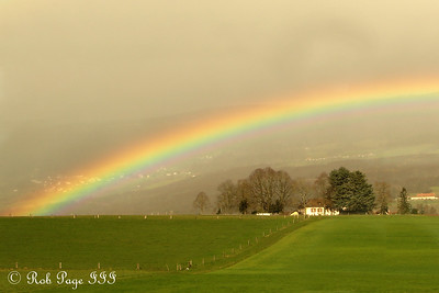 A rainbow over the Suisse countryside on our way to Murten - Switzerland ... March 3, 2007 ... Photo by Rob Page III