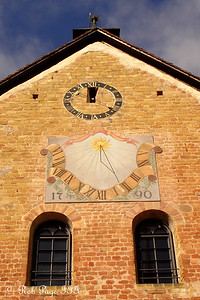The sundial on the side of the castle.  The castle was built by Peter of Savoy in the 13th century - Murten, Switzerland .. March 3, 2007 ... Photo by Rob Page III