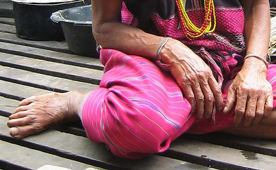 Beautifully weathered hands and feet on this village woman.