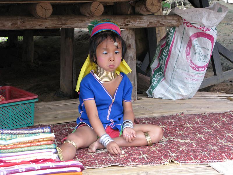 Padong girl playing local game .....