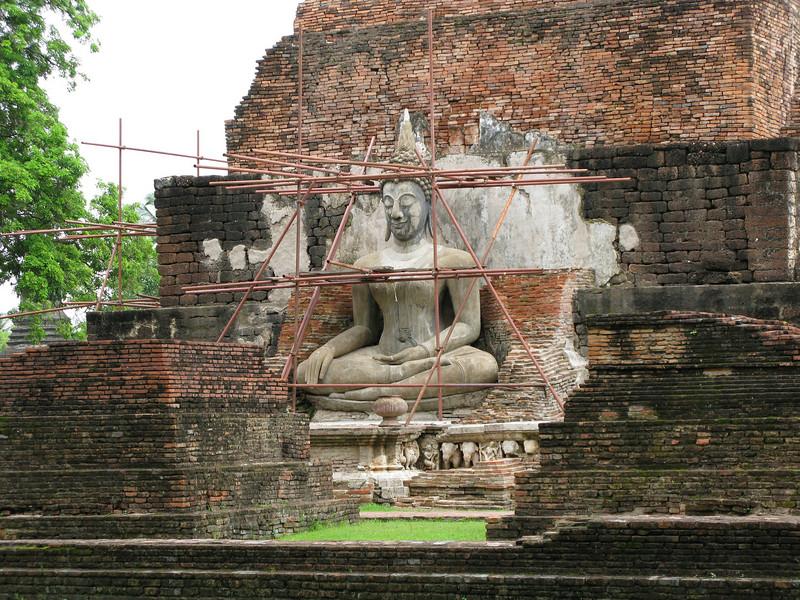 Budda Image being restored at Sukhothai Historical Park