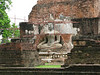 Budda Image being restored at Sukhothai Historical Park