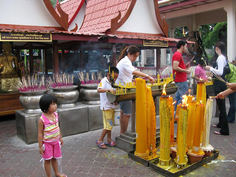 Candles and Incense outside Budda Image Phraputhachinnaraj