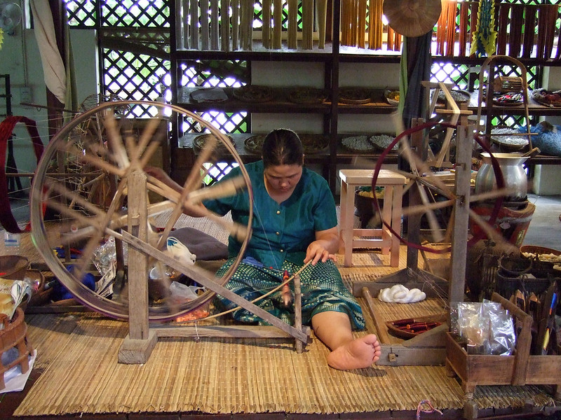 Making silk thread from cocoons.