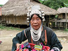 Old woman selling souvenirs and chewing her Beetlenut at the Akka Village (Ban Pa Keaw)