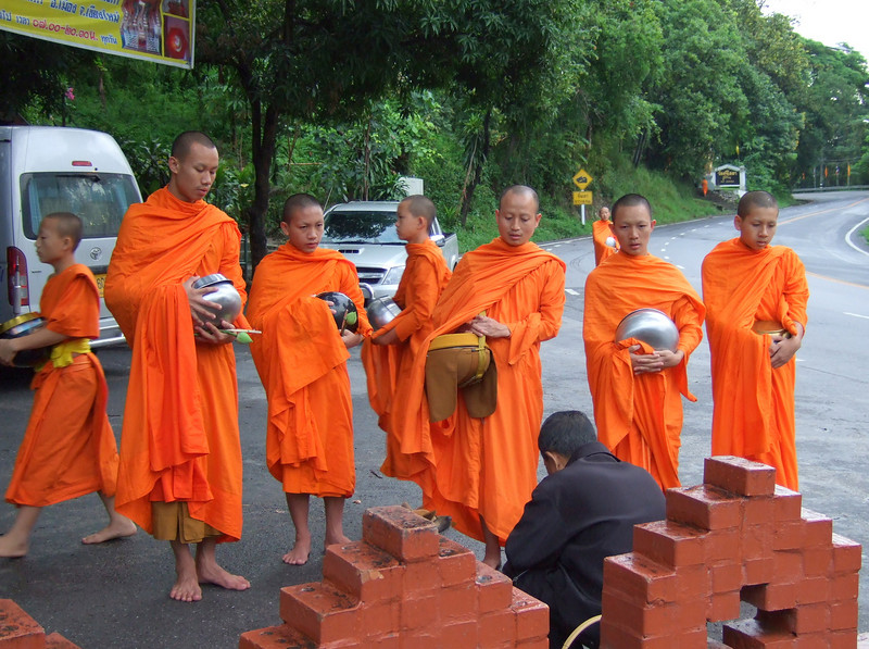 Dawn food offering for Monks and Novices