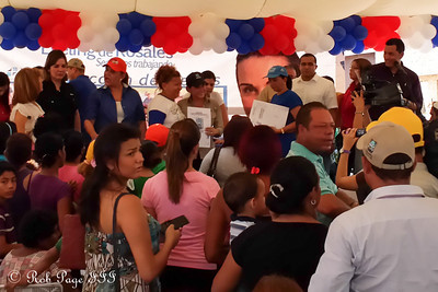 Mayor Eveling Trejo de Rosales presents land titles to Maracaibos newest official residents - Maracaibo, Venezuela ... August 10, 2013 ... Photo by Rob Page III