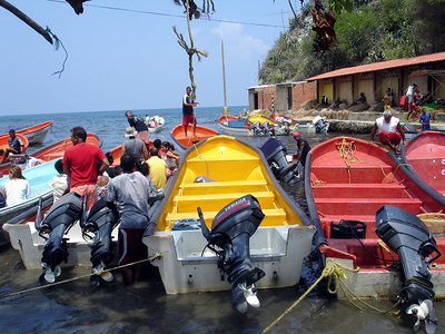 Getting the boats ready for the day - Choroni, Venezuela ... September 24, 2005 ... Photo by Rob Page III