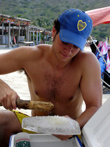 Pedro breaking the block of ice for our drinks - Choroni, Venezuela ... September 24, 2005 ... Photo by Rob Page III