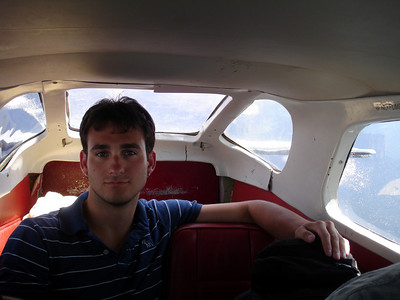John chilling in the back of the bush plane on our flight over Angel Falls.  Notice the blood on the ceiling of the plane.  We weren't sure what it was from - Canaima, Venezuela ... September 29, 2005 ... Photo by Rob Page III