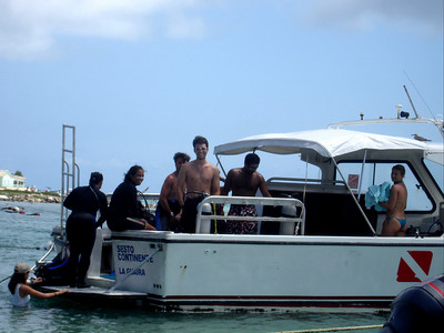 John, getting ready to go scuba diving - Los Roques, Venezuela ... October 1, 2005 ... Photo by Rob Page III