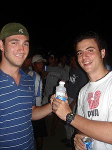 John, nursing his bottle of real medicine while Pedro enjoys a beer - Los Roques, Venezuela ... September 30, 2005 ... Photo by Rob Page III