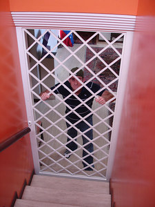 John trapped in Pedro's house - Caracas Venezuela ... September 23, 2005 ... Photo by Rob Page III