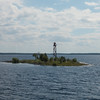 Ostrov Voroniy lighthouse in Velikaya Bay.