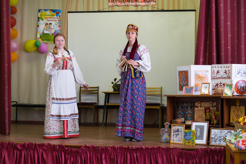 Students do an artistic performance in Kuzino.