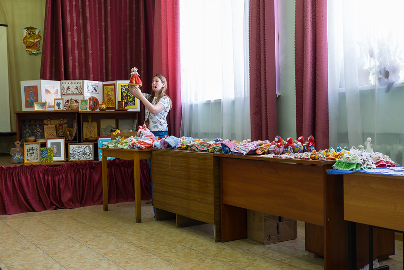 Selling hand made school souvenirs in Kuzino, Russia.