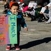 Gabriel Ramos, only 15-month-old, marches around with a sign during the International Women's Day celebration at the Cleghorn Youth Center in Fitchburg on Wednesday, March 8, 2017. SENTINEL & ENTERPRISE / Ashley Green