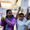 "Children hold signs and sing along to Katy Perry's song ""Roar"" during the International Women's Day celebration at the Cleghorn Youth Center in Fitchburg on Wednesday, March 8, 2017. SENTINEL & ENTERPRISE / Ashley Green"