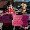 Luis Gutierrez, 11, and David Baez, 11, hold signs during the International Women's Day celebration at the Cleghorn Youth Center in Fitchburg on Wednesday, March 8, 2017. SENTINEL & ENTERPRISE / Ashley Green