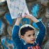 Alexander Baez holds up a sign during the International Women's Day celebration at the Cleghorn Youth Center in Fitchburg on Wednesday, March 8, 2017. SENTINEL & ENTERPRISE / Ashley Green
