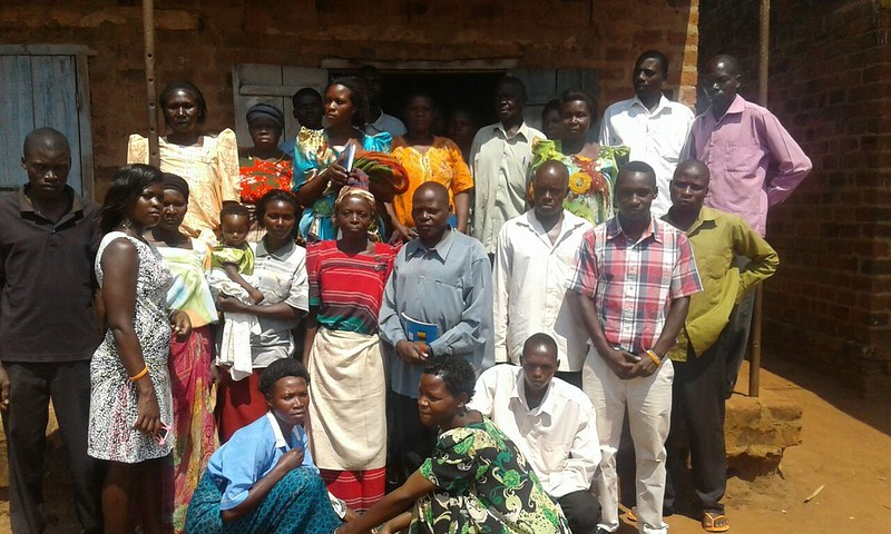 a group gathered outside of HOLD Uganda