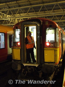 A staff member poses for the camera on 2409. Fri 12.01.07