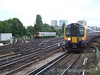 450085 bears down on Clapham Jct as a Cl. 313/1 arrives with a West London Line service. Wed 19.09.07