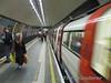 A tube train departs Clapham Common's narrow Island Platforms. Sat 13.12.08