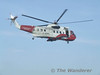 Another view of the Coastguard Helicopter as it flies very close to Ryde Pier Head station. Sun 11.05.08