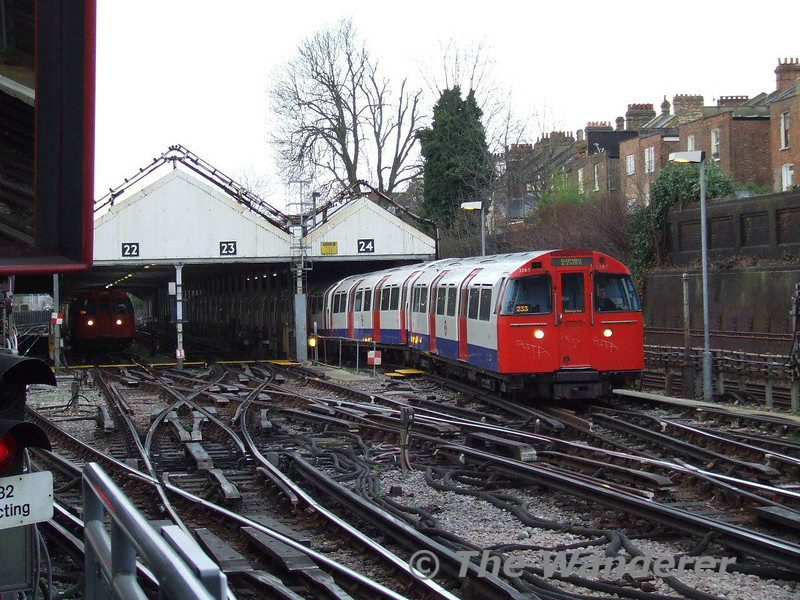 A Harrow & Wealdstone - Elephant & Castle service emerges from the Carriage Shed at Queens Park. Between Queens Park and Harrow & Wealdstone the Bakerloo Line operates over Network Rail lines. The access the Watford DC lines the trains must pass through the outer two roads of the carriage shed. Sat 26.01.08
